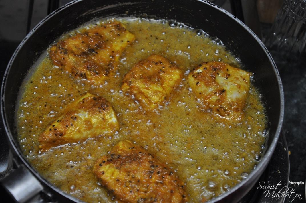 Fry the fish in hot oil