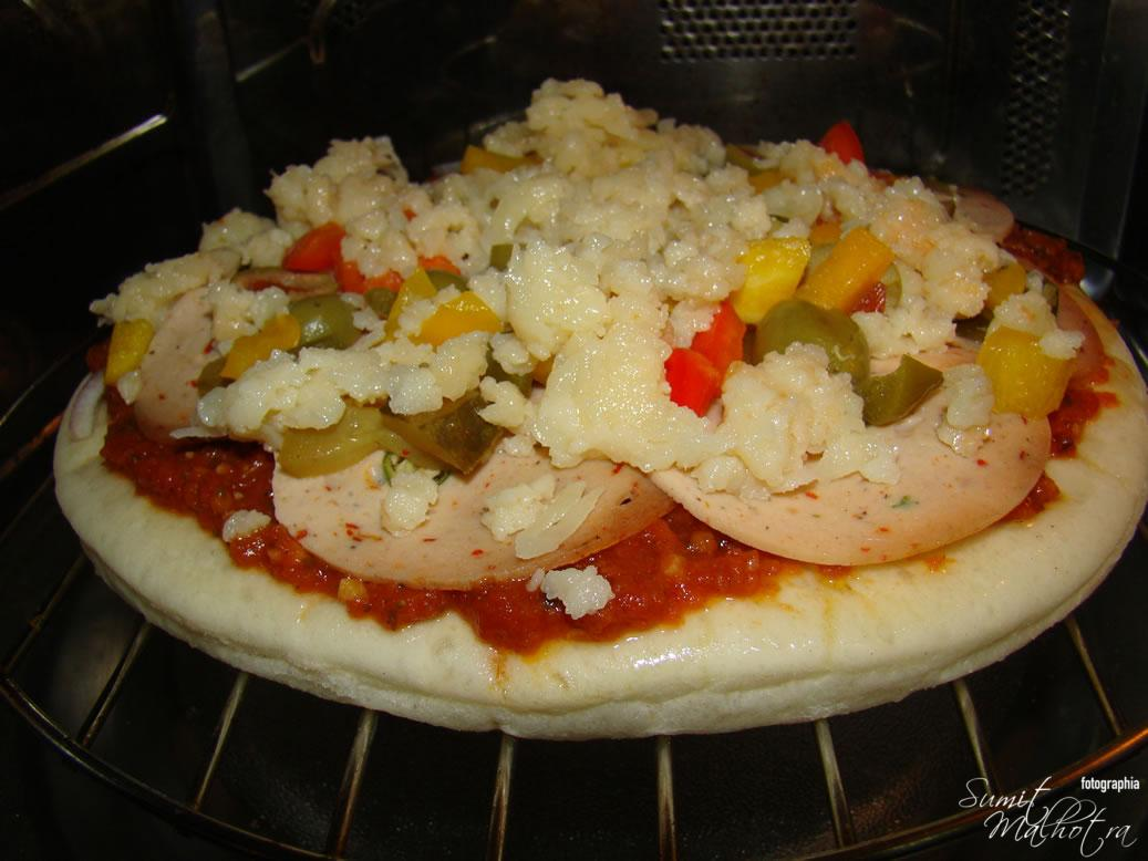 Pizza Base Covered with Fresh Mozzarella Cheese