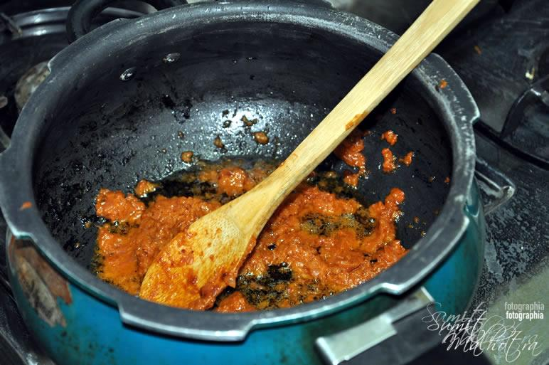 Fry the masala for spicy mutton curry
