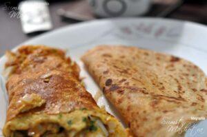Serve East Indian Bottle Masala Omelette hot with paranthas