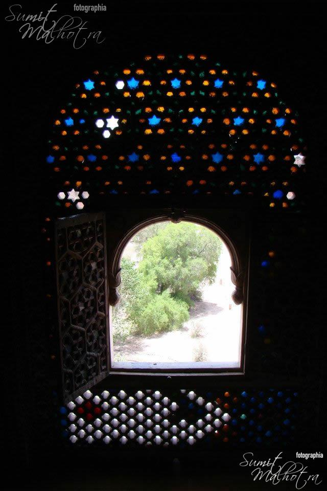 Coloured window jaali overlooking the gardens