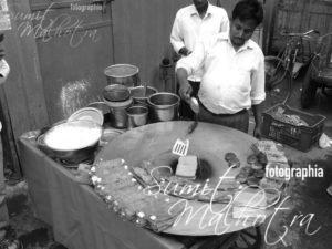 Making besan ka chila near the exit of Chandni Chowk metro station