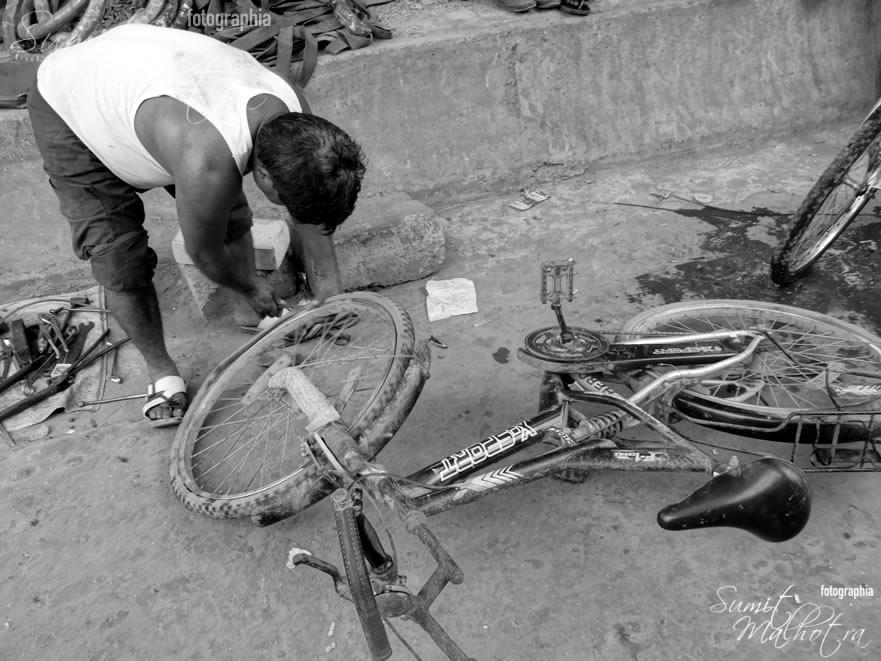 A bicycle repairman in the lane leading to Jama Masjid