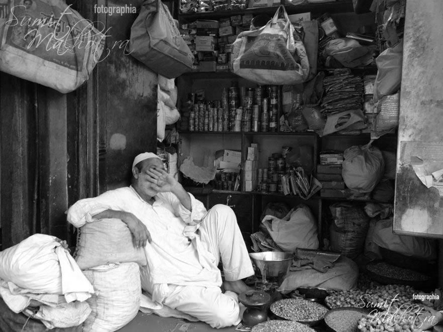 Time for an afternoon snooze - Shopkeeper in Matia Mahal