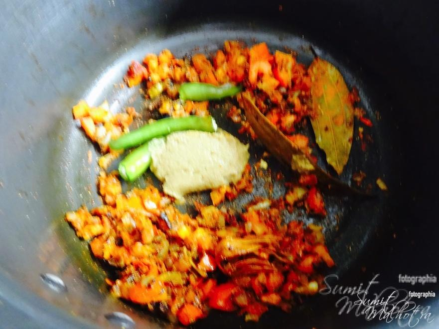 Add green chilies and ginger garlic paste