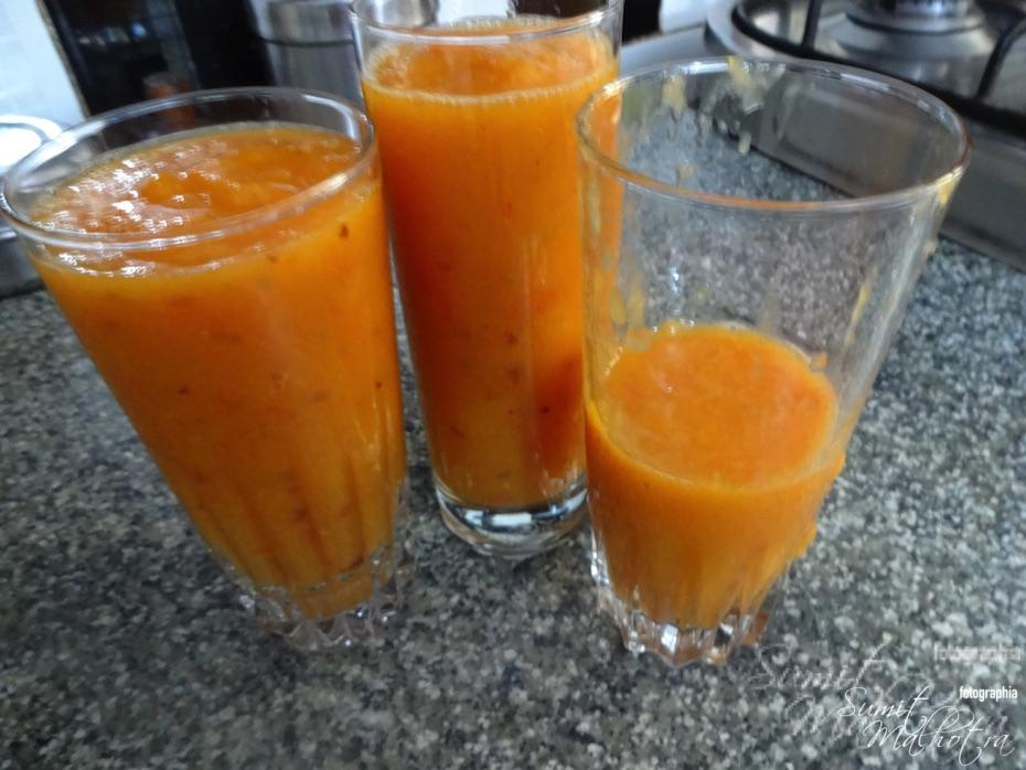 Blitz and serve mango apple tomato smoothie in tall glasses