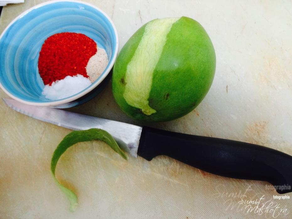 Clean up the raw mango and get spices together
