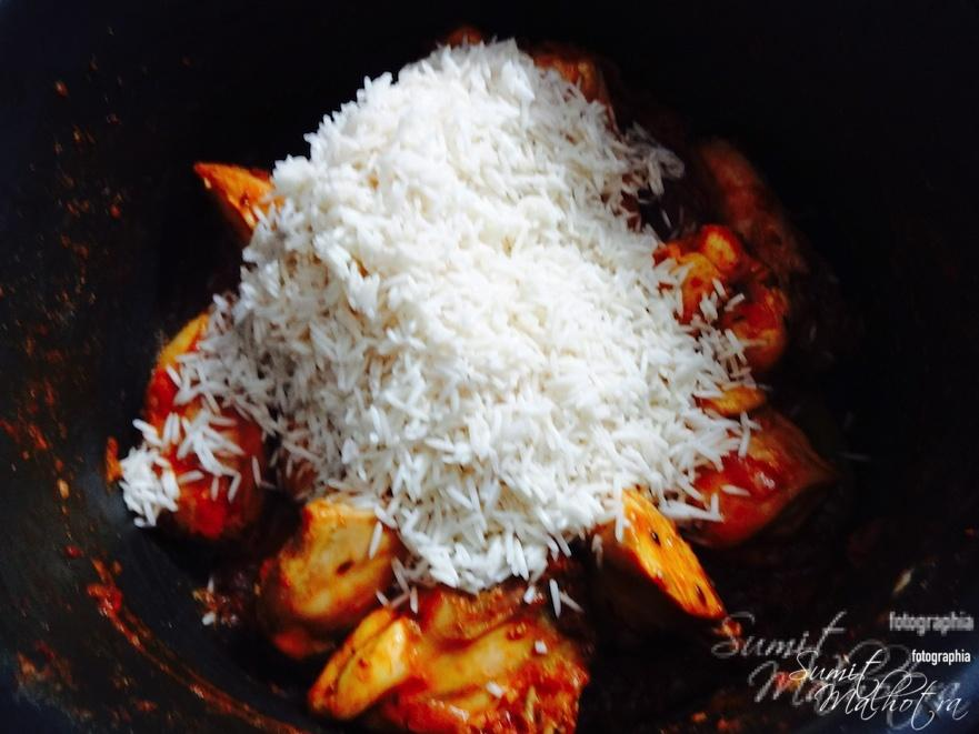 Once chicken is almost cooked add one cup of rice