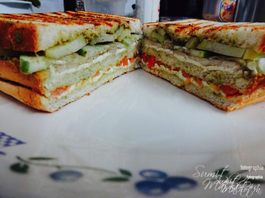 Split Bombay Sandwich into two & serve