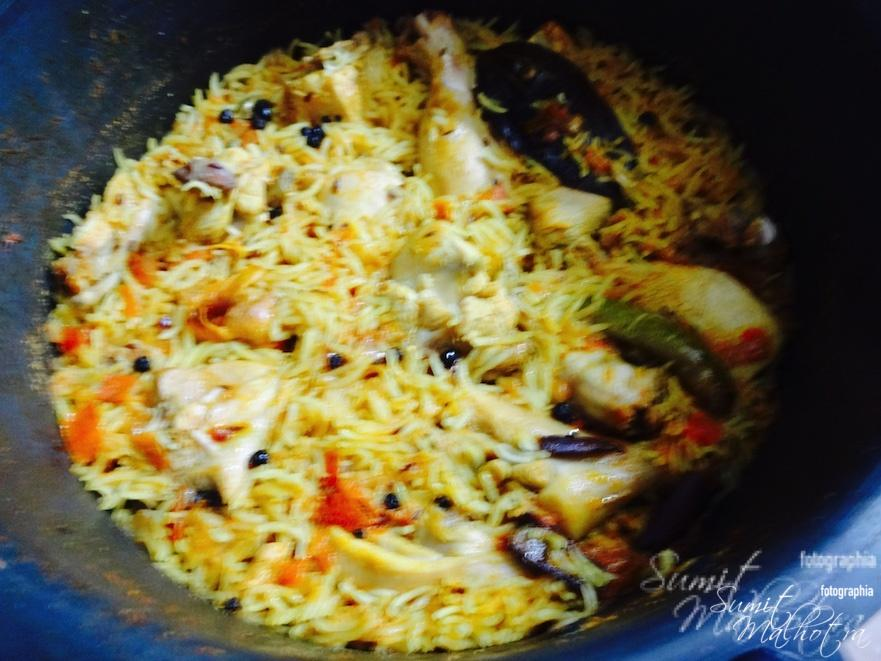 Water is dried and chicken pulao is cooked