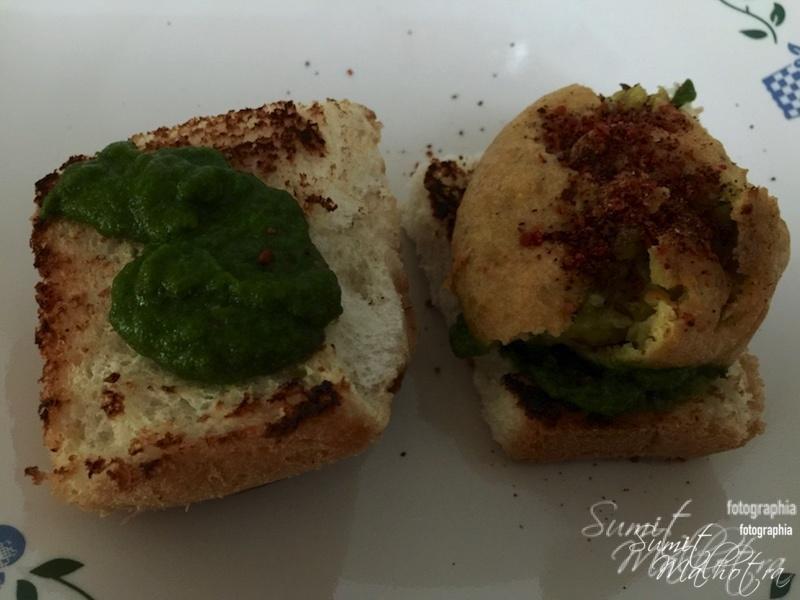 Layer with mint coriander chutney, insert batata vada and sprinkle dry garlic chutney on top