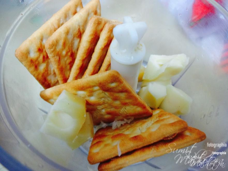 Blitz crackers and cheese in a food processor