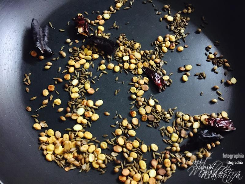Dry roast red chillies, coriander seeds, jeera and chana dal