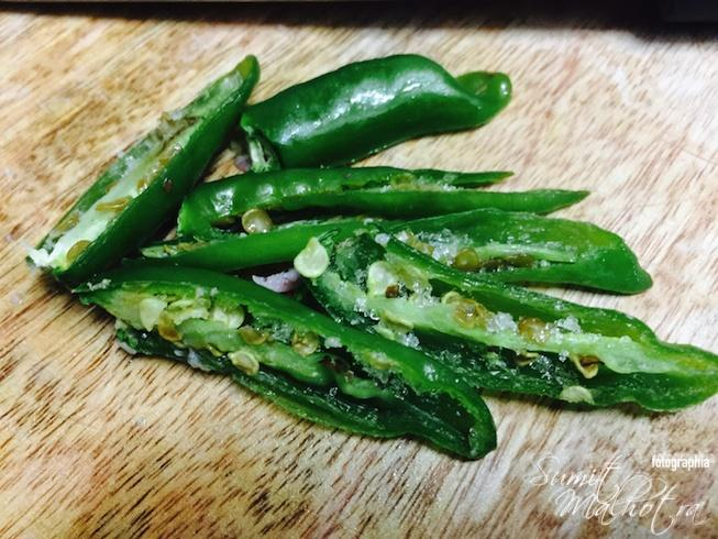 Slice green chillies