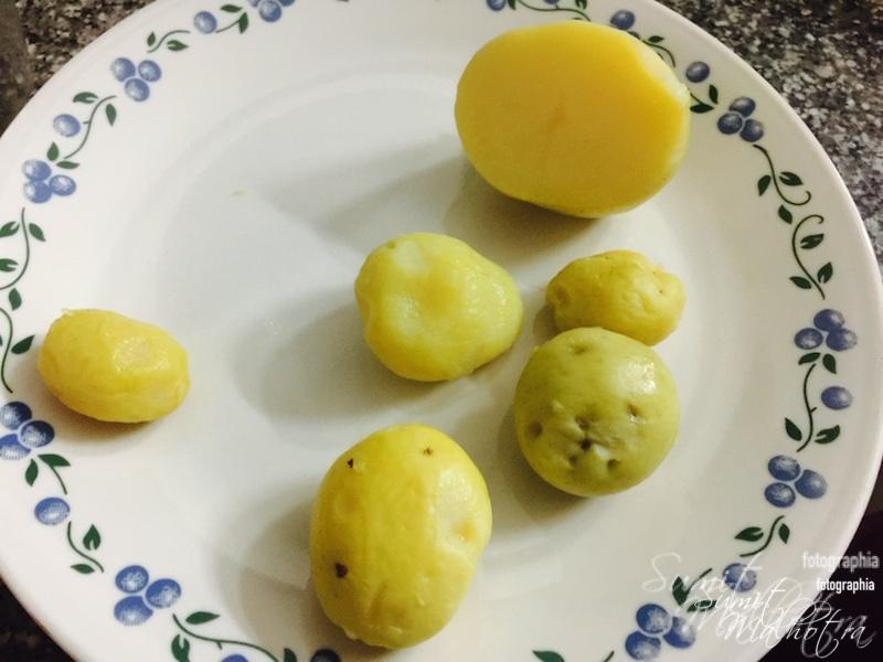 Boil and peel potatoes