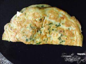 Fold Cheese Oregano Omelette in a nice half moon shape