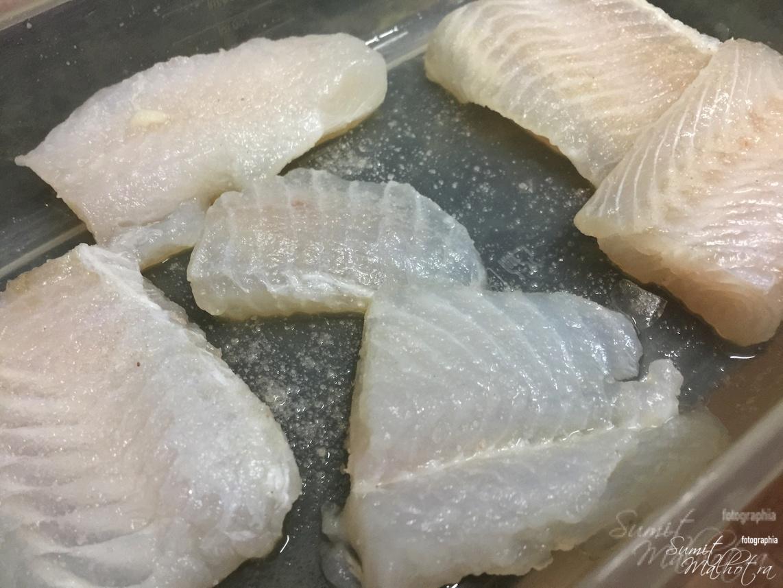 Immerse basa fish in lemon juice and salt