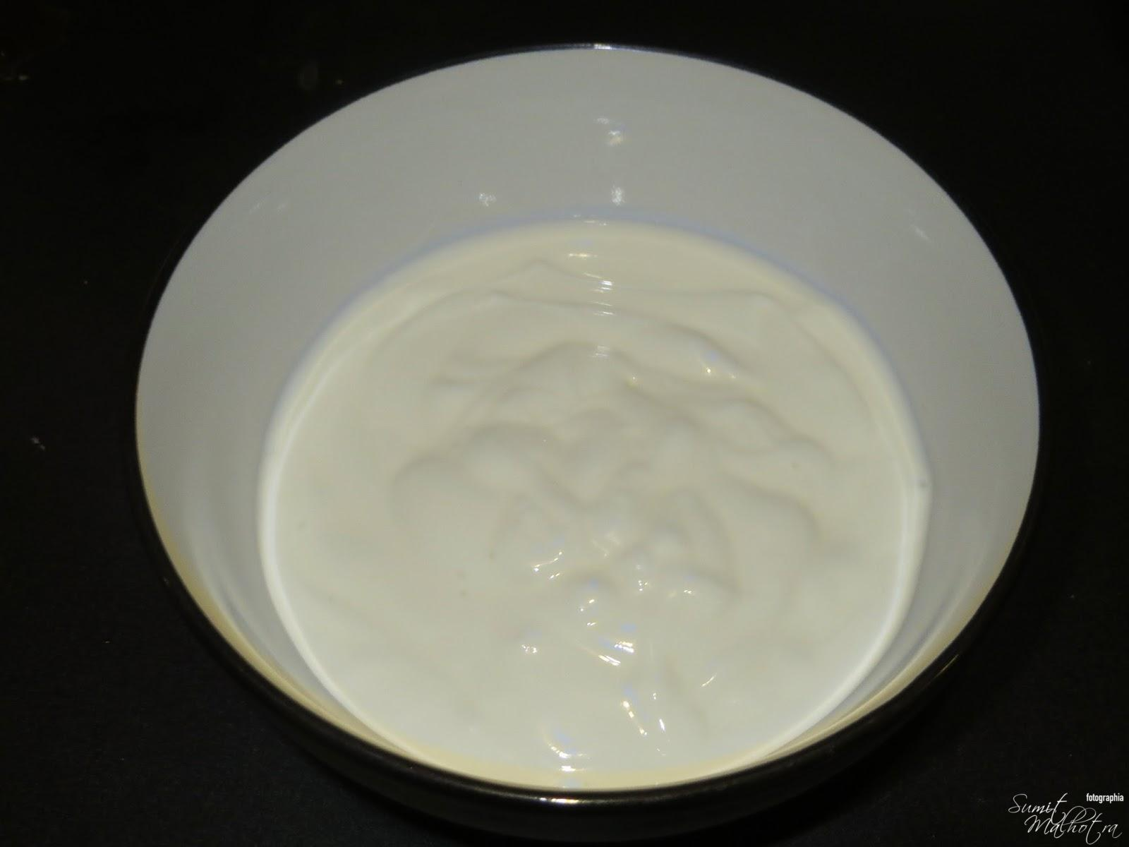 In a mixing bowl, whisk the yogurt.