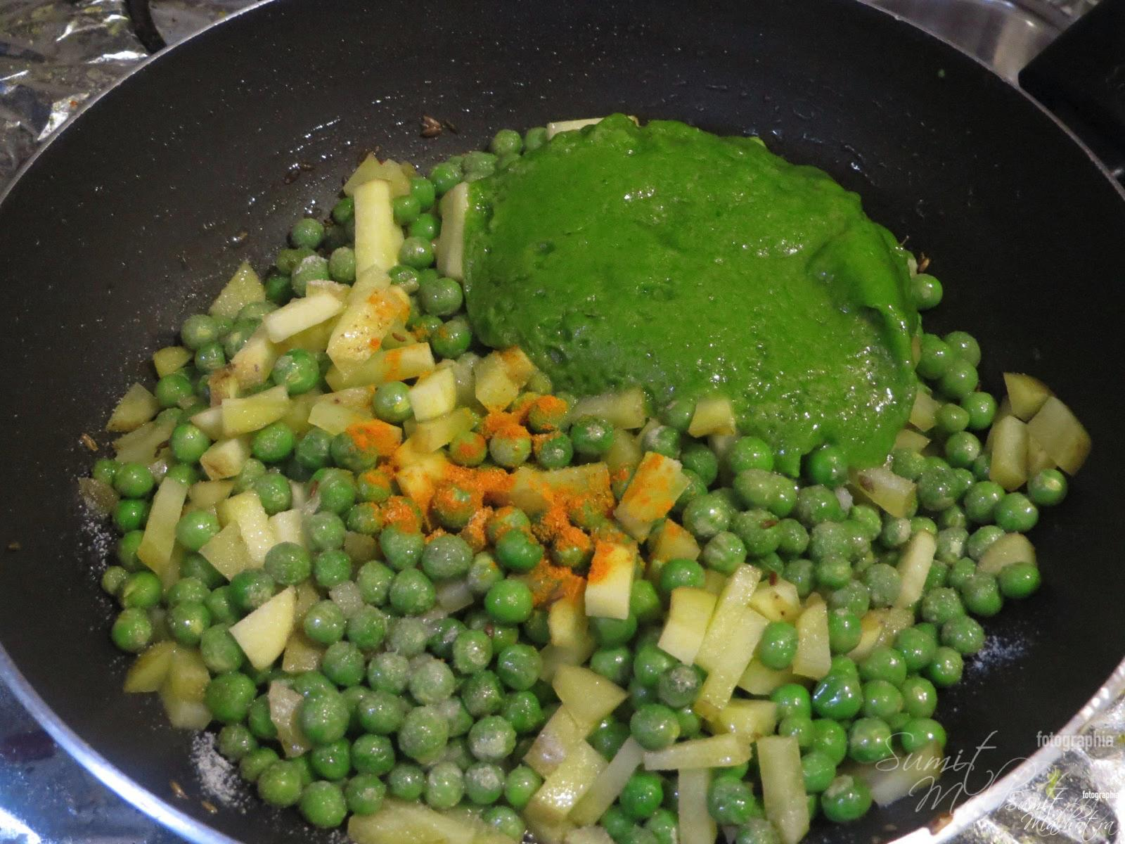 Now add the green paste from step 1, turmeric powder and salt. Mix it well. Cover it and let it cook for 2-3 min.