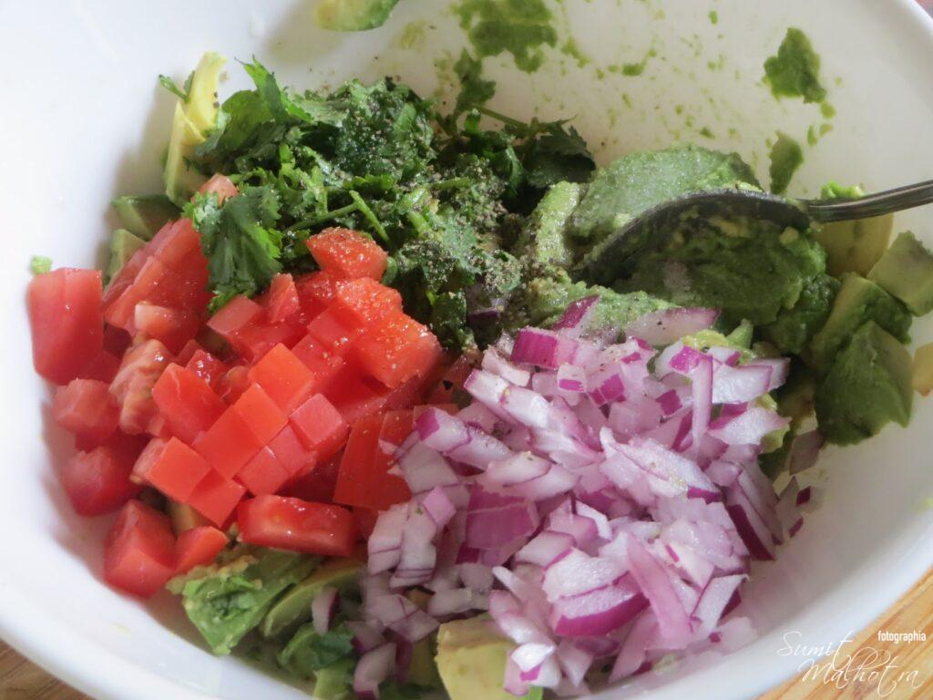 Add chopped onion, tomato, lemon juice, coriander, black pepper powder and salt
