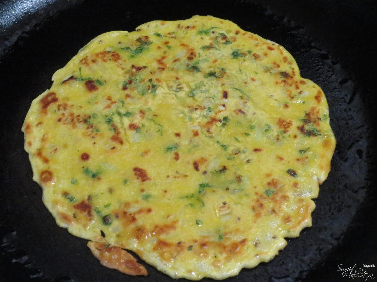 Cook besan chilla until golden brown from both sides