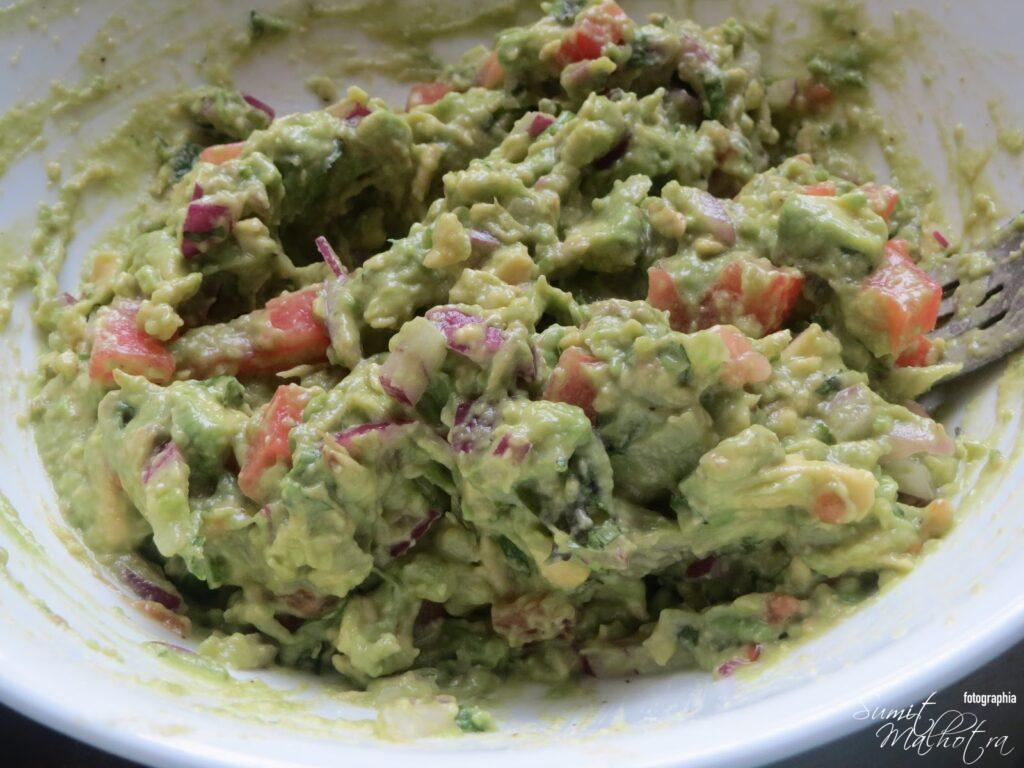 With the help of fork mix everything for homemade guacamole